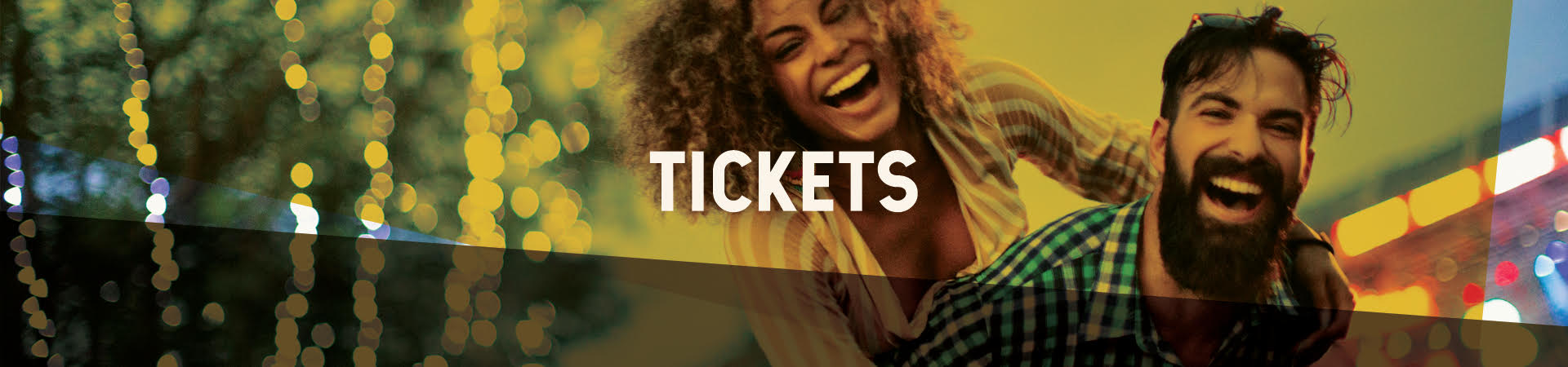 Tickets Web Banner, couple smiling with a stage in the background